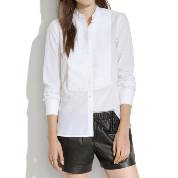 Pleated blouse with mock neck button and black leather shorts