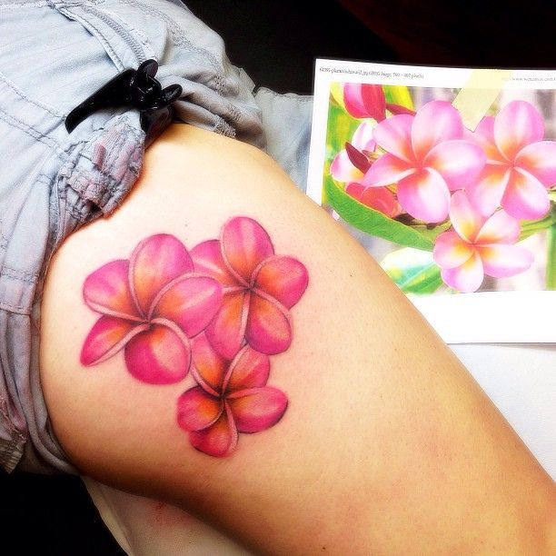 Plumeria tattoo on the thigh