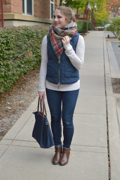 Puffer vest with a gray cashmere scarf and short gray leather boots