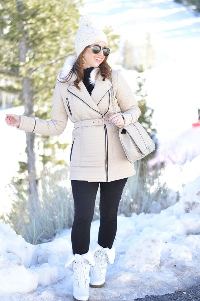 Puffer zipper jacket with black leggings and white snowshoes