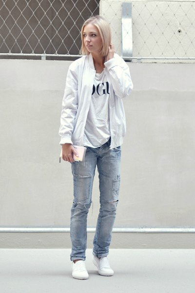pure white bomber jacket with printed t-shirt and blue straight leg jeans