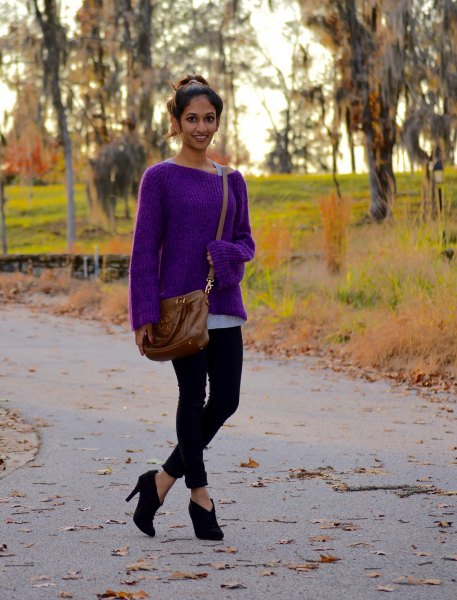 purple sweater with boat neckline and black skinny jeans