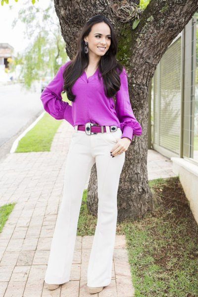 purple button blouse with white flared jeans
