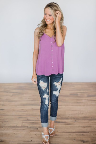purple buttoned waistcoat with ripped skinny jeans