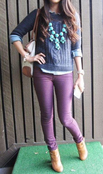 purple knitted sweater with matching skinny jeans