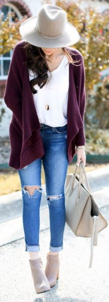 purple chunky zippered cardigan and ripped skinny jeans