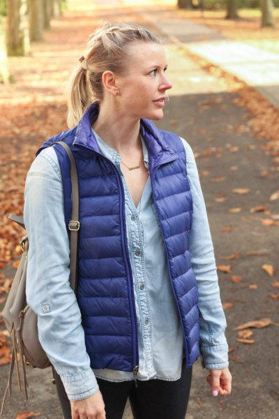 purple down vest with light blue chambray shirt with buttons