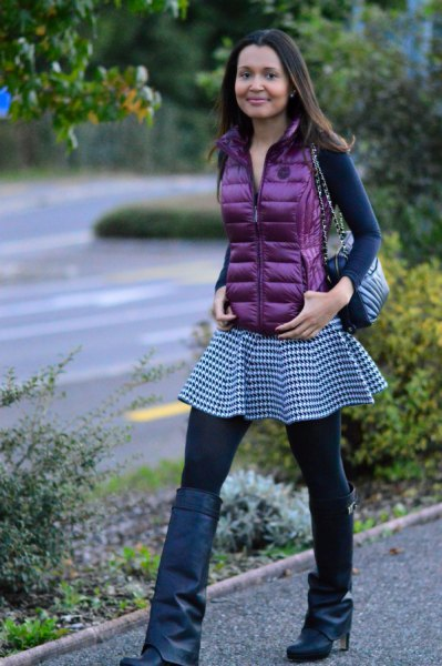 purple down vest with long-sleeved, figure-hugging T-shirt and checked tunic