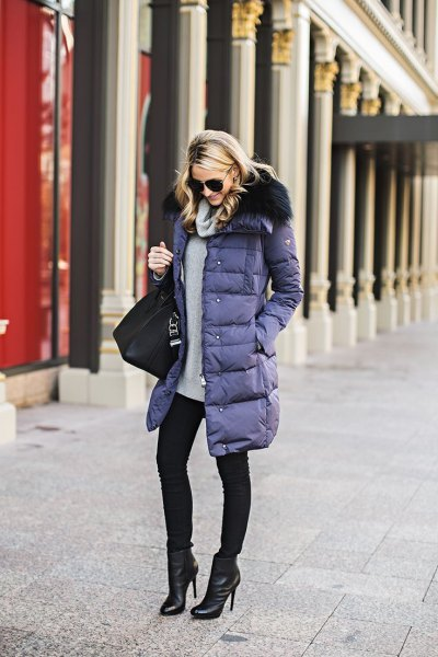 purple long puffer coat with gray sweater and black skinny jeans