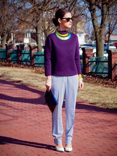 purple long-sleeved top with white and dark printed pants with a relaxed fit