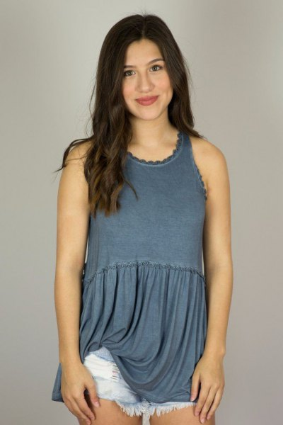 Tunic top with purple pleated hem and blue mini denim shorts