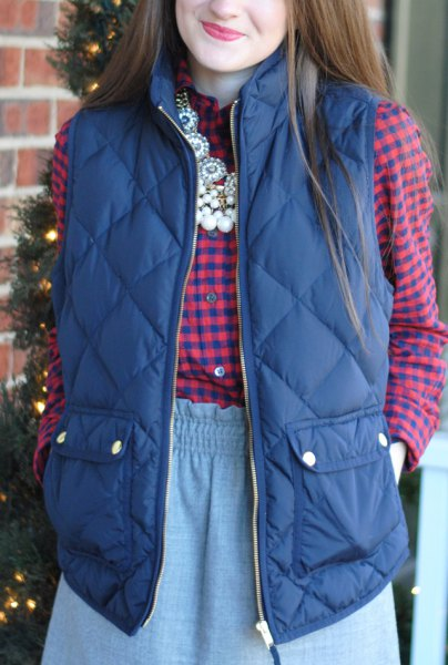 purple quilted vest with blue-pink checked shirt