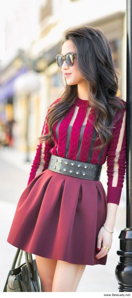 purple semi-transparent mini dress with wide black studded belt