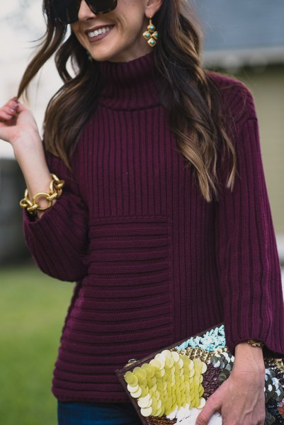 purple turtleneck with turtleneck and black and yellow clutch