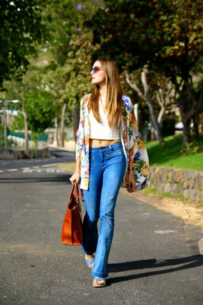 Rainbow-colored printed oversized blazer with light blue boot cut jeans