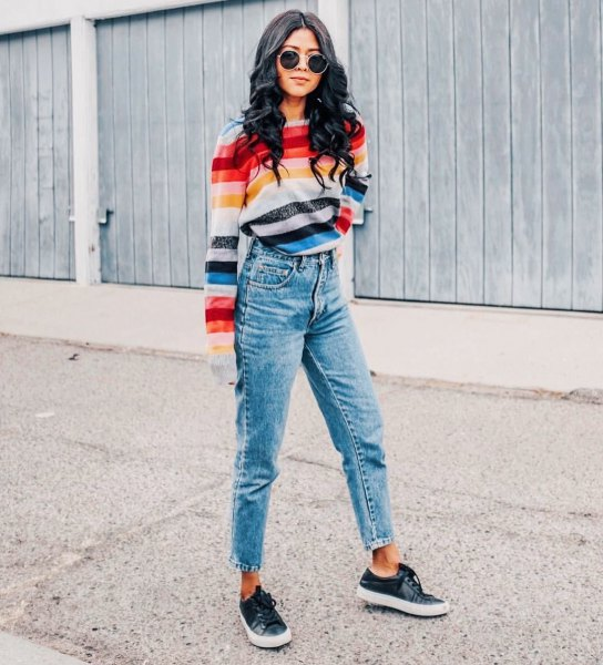 Rainbow-colored striped sweater with cropped mom jeans