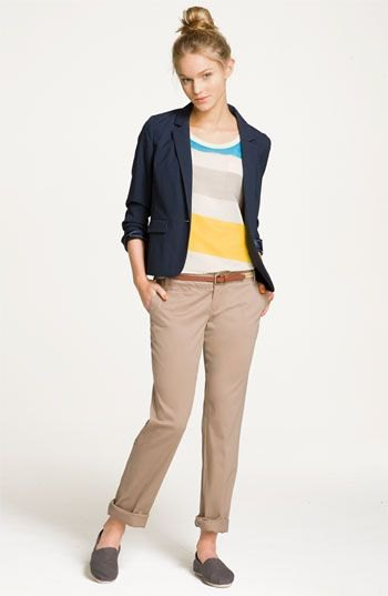 Rainbow colored sweater with dark blue travel blazer and cropped pants