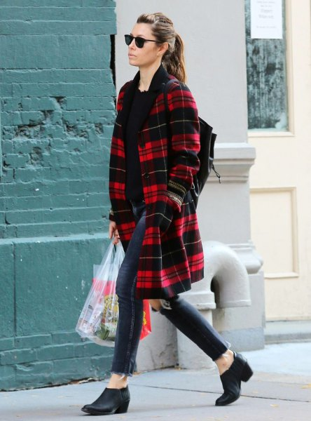 red and black midi checked coat with dark blue skinny jeans