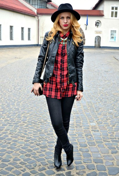 red and black oversized shirt with leather jacket and felt hat