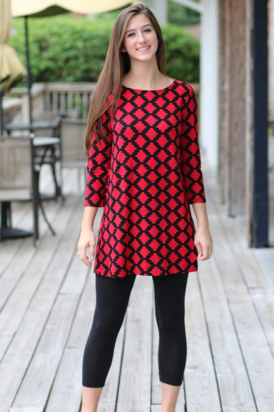 red and black patterned top with short leggings