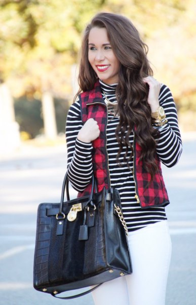 red and black checked vest with full zip, black and white striped mock neck top