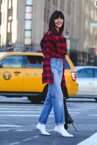 red and black checked shirt with blue jeans with straight cut and white boots with kitten heel