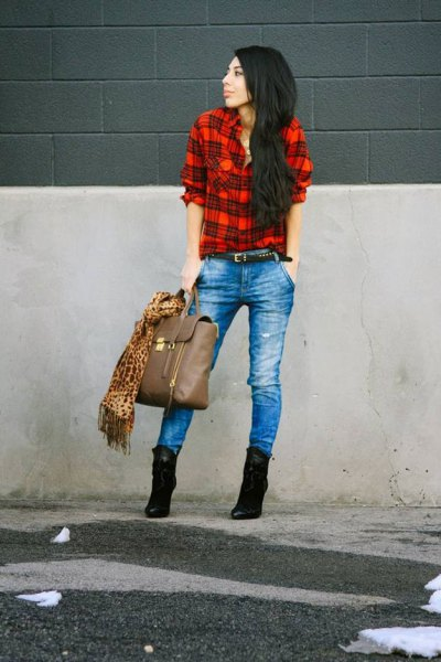 red and black shirt with blue jeans and suede ankle boots with heel