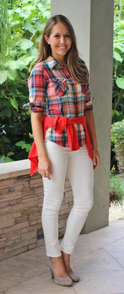 red and blue plaid boyfriend shirt with cream-colored jeans