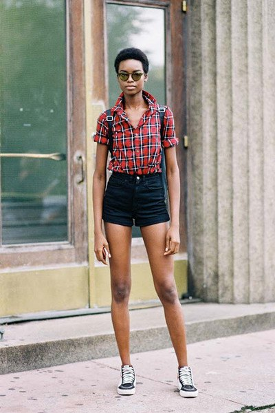 red and blue plaid shirt with buttons and black mini high-rise shorts