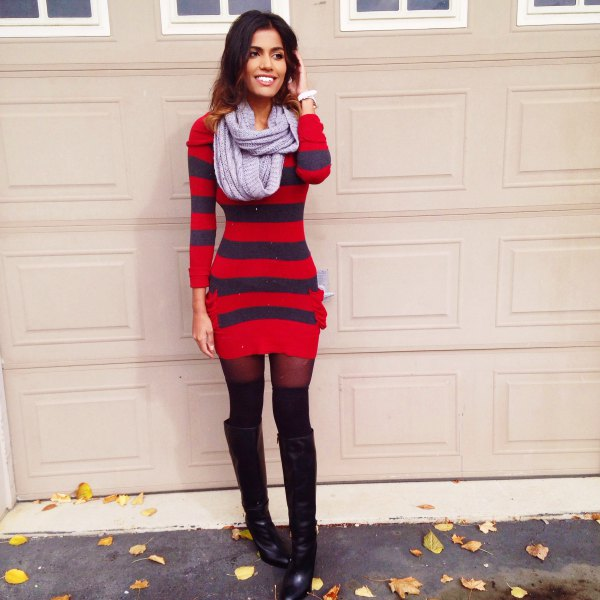 red and dark blue striped, figure-hugging sweater dress with black overknee boots