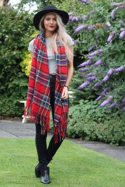 red and dark blue tartan scarf black felt hat