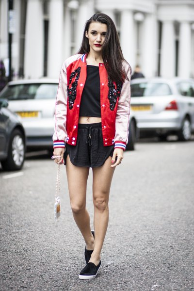 red and pale pink baseball bomber jacket with black mini shorts