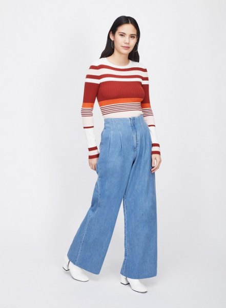 red and white color block sweater with light blue jeans with wide legs