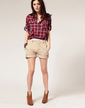 red and white checked boyfriend shirt with beige shorts with cuffs