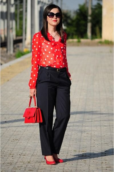 red and white polka dot shirt, black chinos with wide legs
