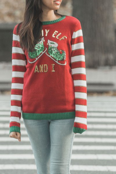 red and white striped knitted sweater with round neckline and light gray skinny jeans