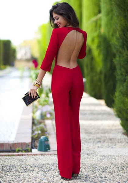 red backless jumpsuit with wide legs