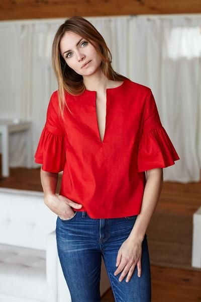 red bell-sleeved blouse blue jeans