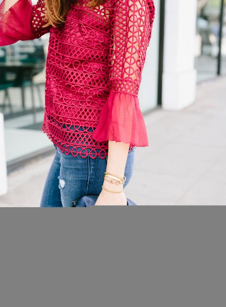 Red crochet lace blouse with bell sleeves and skinny jeans