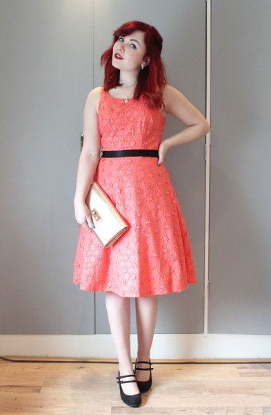 sleeveless fit with a red belt and a flared midi dress