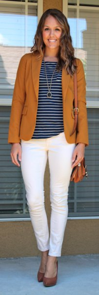 red blazer with striped t-shirt and ankle jeans