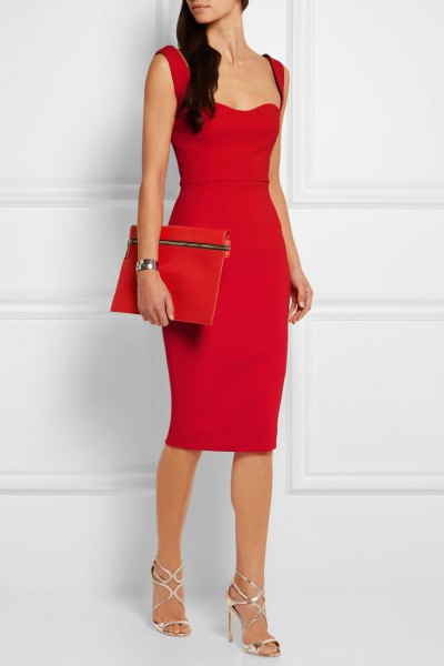 red figure-hugging midi dress clutch