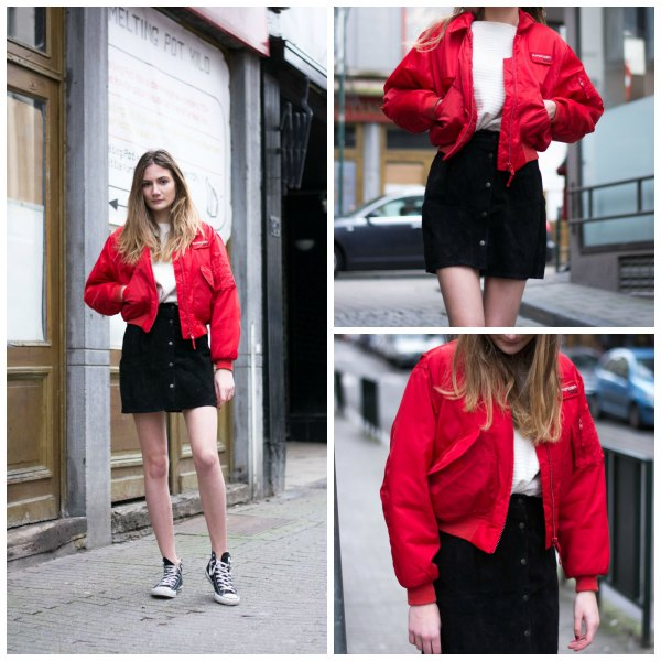red bomber jacket with black denim mini skirt with button placket