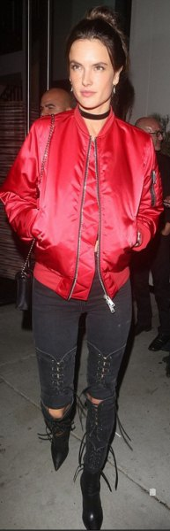 red bomber jacket with black skinny jeans