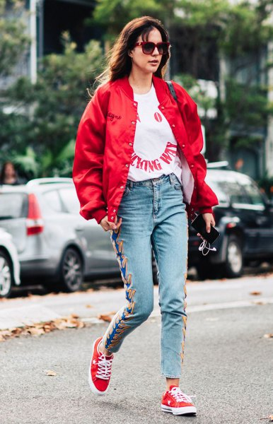 red bomber jacket with white graphic t-shirt and embroidered mom jeans