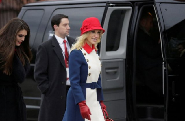 red bush hat with white and blue coat dress