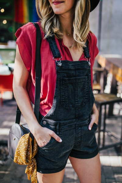 red cap sleeve blouse black denim shorts