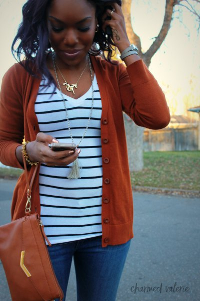 red cardigan sweater with white and black striped V-neck