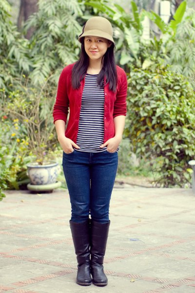 red cardigan with black and white striped t-shirt and bucket hat