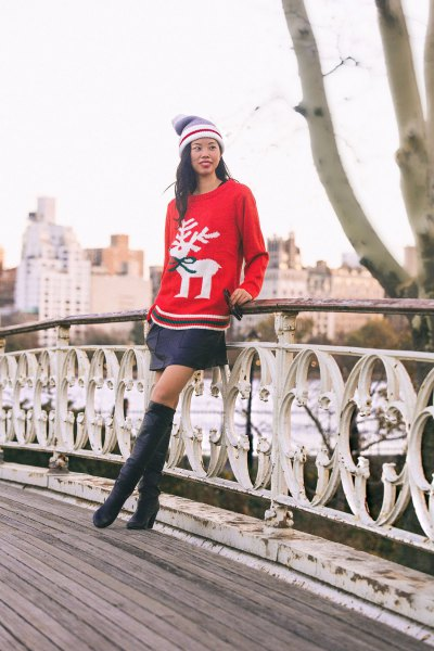 red Christmas holiday sweater with black mini skirt